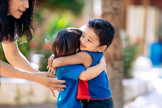 Children hugging at Journey School